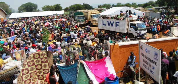 sudan refugees at camp entrance.jpg